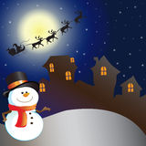 House on christmas day. House and snowman on christmas day Royalty Free Stock Image