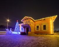 House Christmas lights at night. House with bright holiday Christmas lights at night Royalty Free Stock Photos