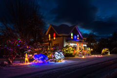 House with Christmas lights. Snow covered house with vibrant colors Christmas lights and decorations in Gates, Oregon stock image