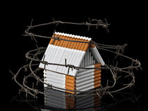 The house from cigarettes behind a barbed wire Stock Image