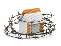The house from cigarettes behind a barbed wire Royalty Free Stock Photos