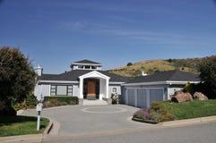 House with circular driveway, three car garage stock photo