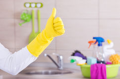 House cleaner showing ok sign royalty free stock image