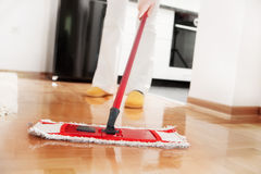 House cleaning. Mopping hardwood floor Stock Photo