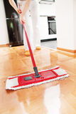 House cleaning. Mopping hardwood floor Stock Photography