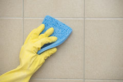 House cleaning of floor tiles with sponge Stock Image