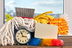 House cleaning items and alarm clock. stock photos