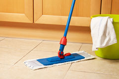 House cleaning with the mop Stock Images