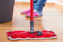 House Cleaning. House mopping and cleaning floor Royalty Free Stock Image