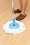 House cleaning. Mopping hardwood floor Royalty Free Stock Images