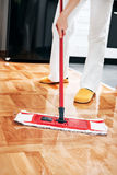 House cleaning. Mopping hardwood floor Stock Photos