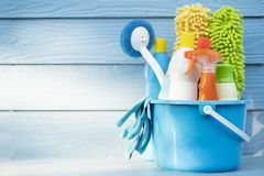 House cleaning product on wood table. With blue background royalty free stock images
