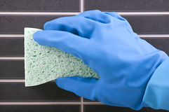 House cleaning - Scrubbing tiles Stock Image