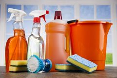 Cleaning products. Home concept and window background. House cleaning with various cleaning tools stock photography