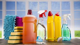 Cleaning products. Home concept and window background. House cleaning with various cleaning tools royalty free stock photography