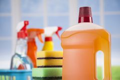 Cleaning products. Home concept and window background. House cleaning with various cleaning tools royalty free stock images
