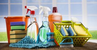Cleaning products. Home concept and window background. House cleaning with various cleaning tools stock photos