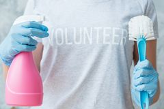 House cleaning volunteer service atomizer brush. House cleaning concept. Volunteer service. Female torso with atomizer and brush stock images