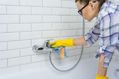 Free House Cleaning. Woman Is Cleaning In The Bathroom At Home. Royalty Free Stock Photography - 116693967