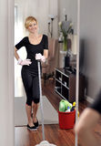 House cleaning, woman is mopping wood floor. House cleaning, woman is mopping floor, bucket with detergent Stock Image