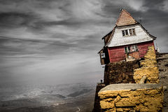 House on a cliff - Living on the edge Royalty Free Stock Images