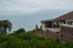 House on a Cliff with Ocean View in Knysna, Garden Route Stock Photo