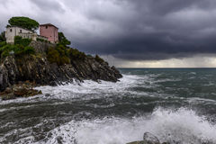 House on cliffs at rainstorm (Nervi, ,Italy) Royalty Free Stock Photo