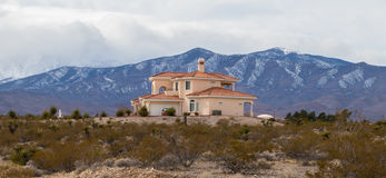 house close to the mountains. Beautiful alone house close to the road in the way to Mount Charleston, Nevada Royalty Free Stock Photo