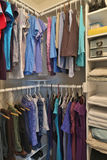 House closet for clothing. Female clothes hanging in house closet royalty free stock image