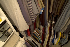 A house closet. Male clothes and towel in house closet royalty free stock photo