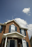 House and Clouds. Subdivision home under a deep blue sky with clouds Royalty Free Stock Images