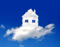House in clouds. Conceptual image - dream of own house Royalty Free Stock Photos