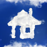 House from clouds Stock Photography