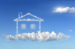 House of clouds dream. House of clouds in the dreams of a blue sky background Stock Photo