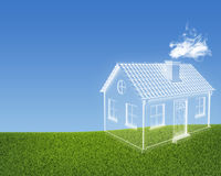 House of clouds in the green grass Royalty Free Stock Images