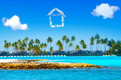 The house from clouds over the sea and palm trees Royalty Free Stock Image
