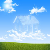 House of clouds in the sky over green grass Stock Photos