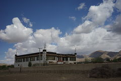House and clouds in Tibet Royalty Free Stock Photography