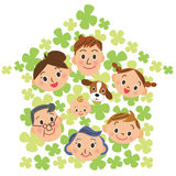 House of clovers and three-generation family Royalty Free Stock Images