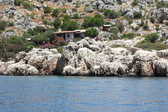 House on the coast. Lodge on the Mediterranean Sea in Turkey Royalty Free Stock Photo