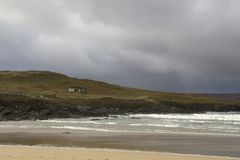 House at the coast with stormy cloud. House near beach in Scotland Royalty Free Stock Photography