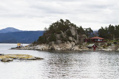 House at coastline on small island Stock Photos