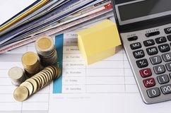 House and coin stack with calculator and bill payment for loan m royalty free stock photography