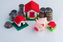 House and coin tower Royalty Free Stock Photography