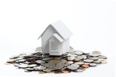House and coins. Stock Photo