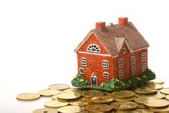 House and coins Stock Photos