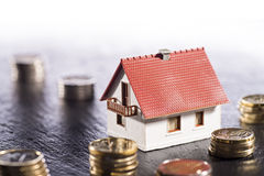 House and Coins Stock Photo