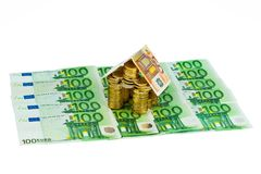 House from € coins from money Stock Photography