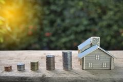 House and coins stack. The concept of purchase of habitation, buy a house. House and coins stack. The concept of purchase ,of habitation, buy a house stock image