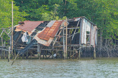 house collapsed after storm at fishing Village on the sea Royalty Free Stock Photo